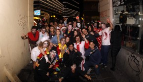 Group photo of Madhouse party hostel guests in costume and ready to party.